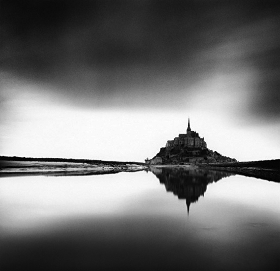 Michael Kenna, Midday Prayer, Mont St. Michel, France, 2004. Sepia-toned gelatin silver print, 7 1/4 x 7 1/2 inches. Courtesy of the artist and G. Gibson Gallery, Seattle.