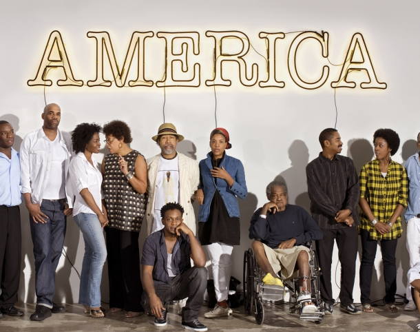 A group of 30 Americans artists, left to right: Rashid Johnson, Nick Cave, Kalup Linzy, Jeff Sonhouse, Lorna Simpson, Carrie Mae Weems, Barkley L. Hendricks, Hank Willis Thomas (front row), Xaviera Simmons, Purvis Young, John Bankston, Nina Chanel Abney, Henry Taylor, Mickalene Thomas (front row), Kerry James Marshall, and Shinique Smith.