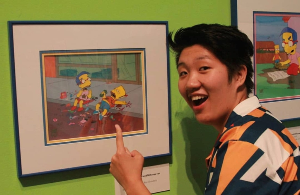 Visitor pointing at animation cel on view in Bart at TAM: Animating America's Favorite Family.