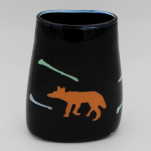 Black basket shaped vessel featuring an image of coyote and coyote bones.