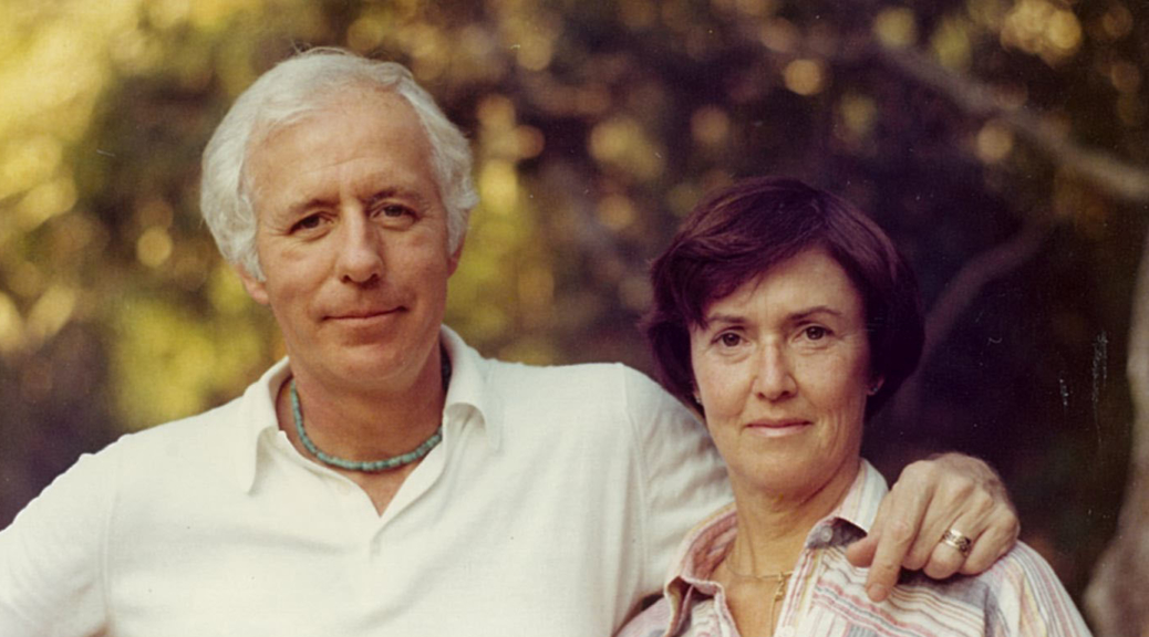 "Barbara ""Bobby"" Neils Street (right) and her husband Bill Street stand in front of a blurred tree background."