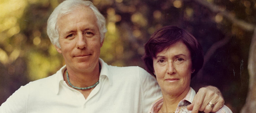 """Barbara """"Bobby"""" Neils Street (right) and her husband Bill Street stand in front of a blurred tree background."""