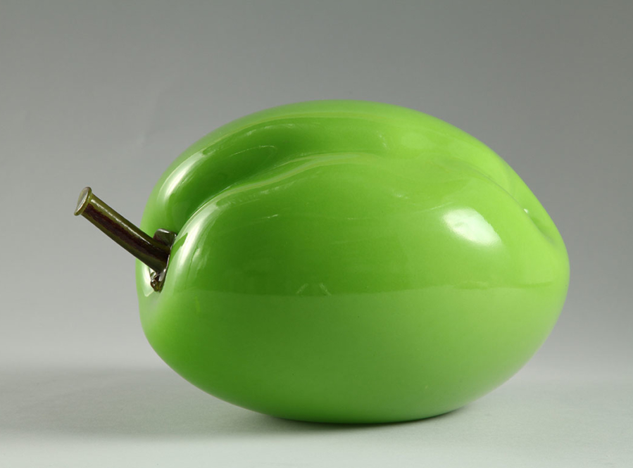 Bulbous, lime-green sculpture of a plum.