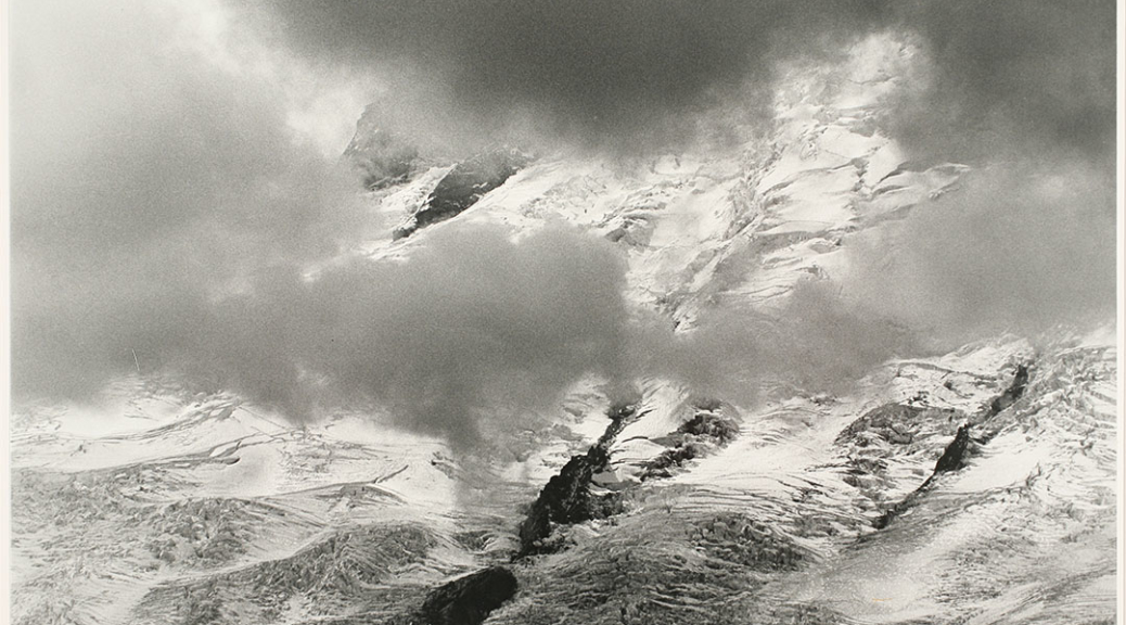 Photograph Credit Line: Museum purchase with funds from Nancy S. Nordhoff in honor of Mary Randlett Object number: 2008.8.20 DescriptionBlack and white photograph of snowy mountains seen through clouds.