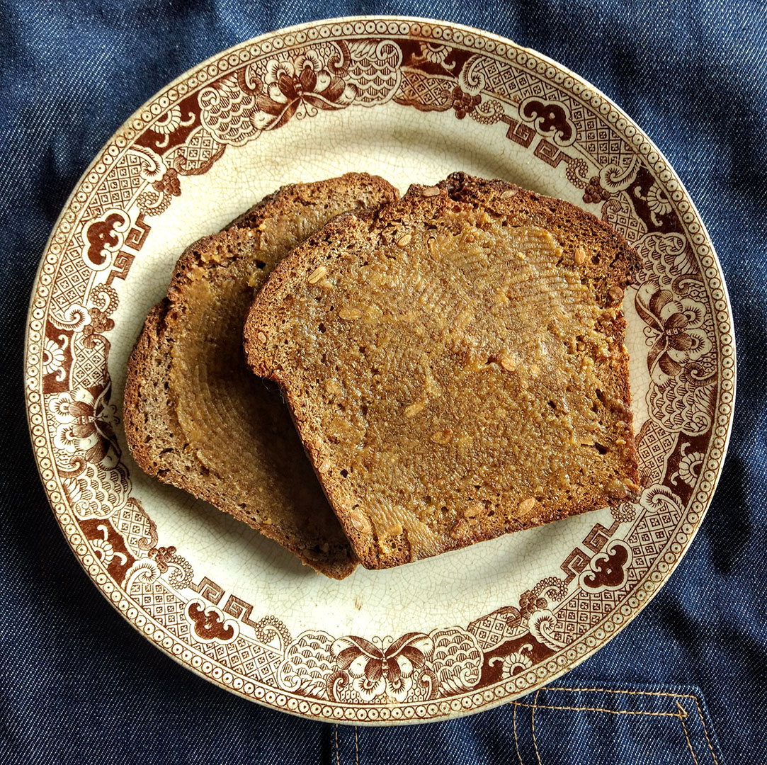 Two pieces of toast on a vintage plate.