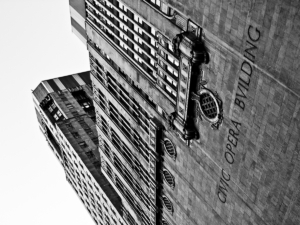 Black and white tilted angle view of a high rise building in Chicago.