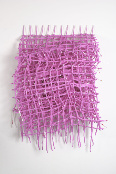 A three-dimensional grid of string covered in pink paint. The weight of the paint has deformed the string grid.