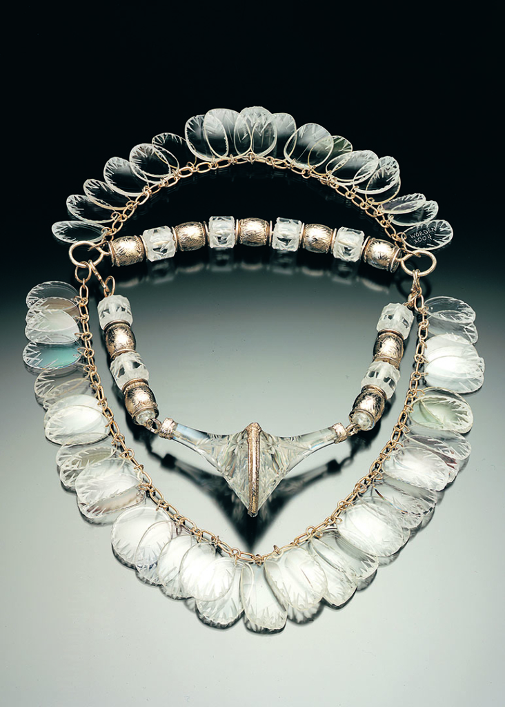 A necklace made from a circle of eyeglass lenses that have a crystal or ice-like appearance.