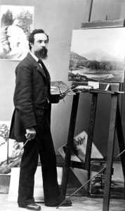 Black and white portrait of painter Grafton Tyler Brown in his studio.