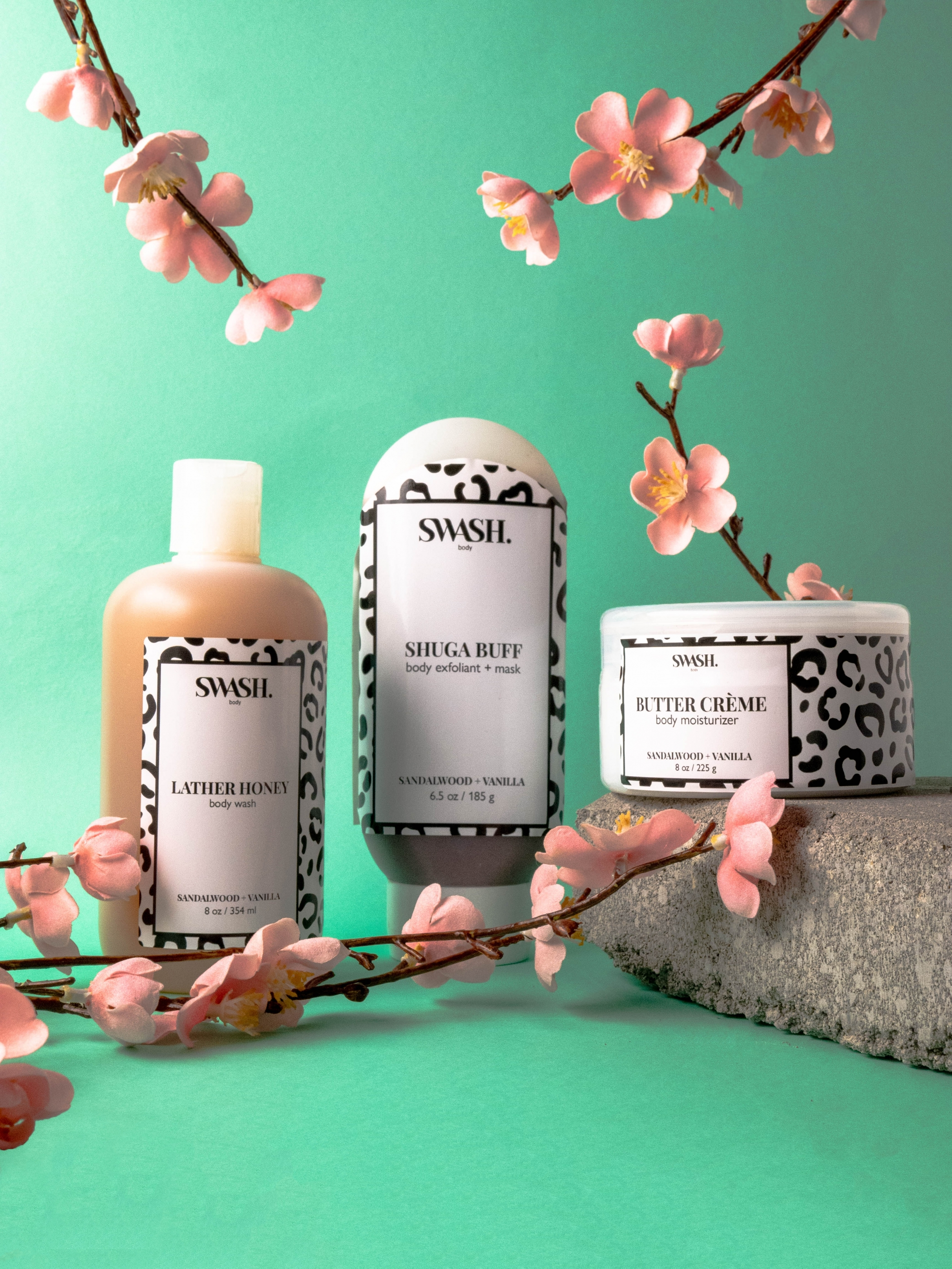 Image of SWASH skincare products displayed with cherry blossoms in front of a blue-green background