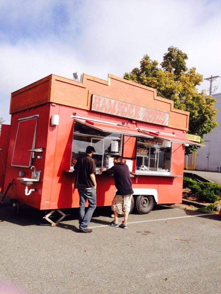 Color photo of HamHock Jones food truck parked in a parking lot and set up for customers.