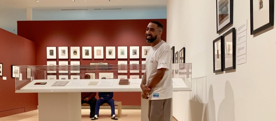 Photo of curator Khalil Kinsey in the Kinsey Collection gallery space.