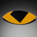 Color photo of jewelry piece by artist Boris Bally