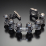 Color photo of untitled jewelry piece by artist Karen Gilbert